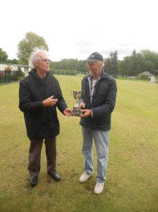 Tournament Manager, Tony O'Donnell presenting Peter Parkinson with the trophy.